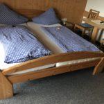 Das gemütliche Bett in der Pension Oberschneider in Kaprun