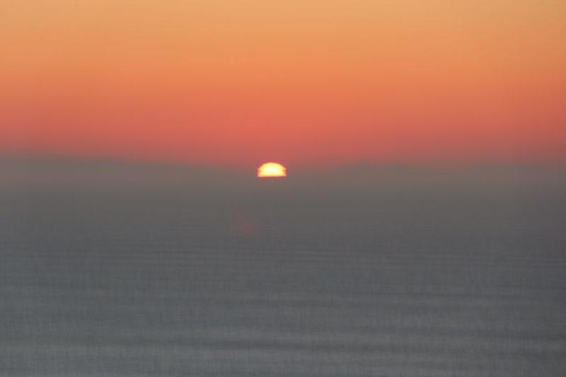 Die Sonne versinkt im Meer bei Slieve League, wenige MInuten später