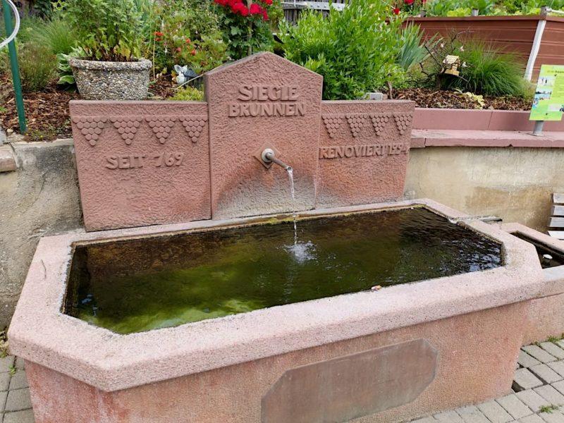 Der Brunnen als Ort Begegnung früher
